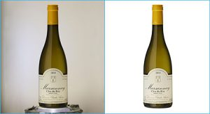 Image retouching applied on a bottle-blended image created by- best clipping path service provider company.